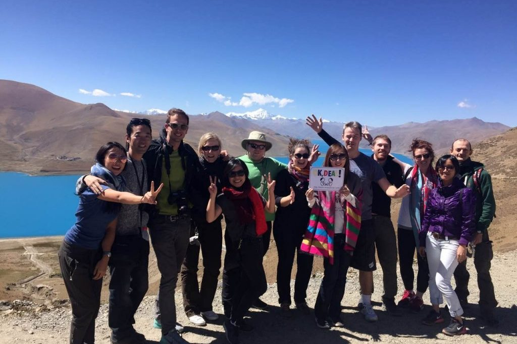 tour group visits Yamdrok tso lake in Tibet during eco tourism tour in Tibet