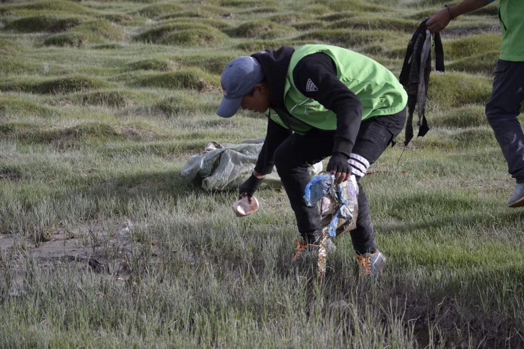Recycling and collecting rubbish is part of eco tourism by Tibet Universal Travel