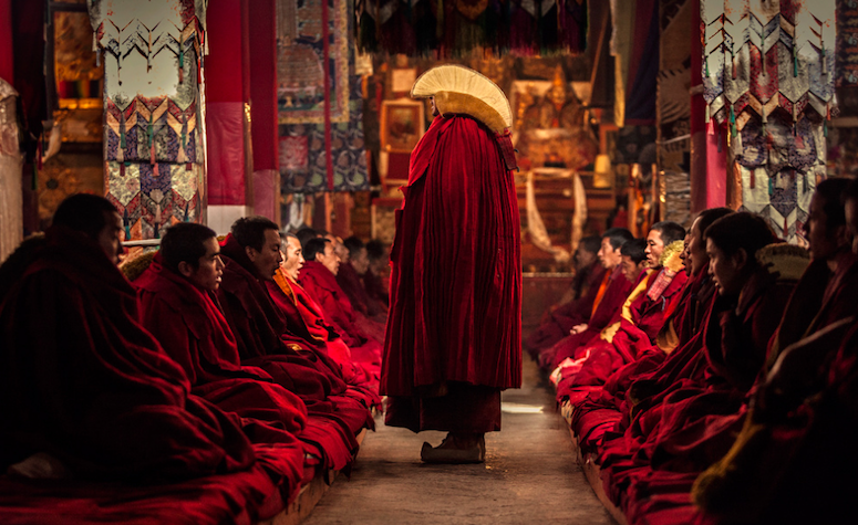 The tibetan mons praying in famous monastery in Tibet