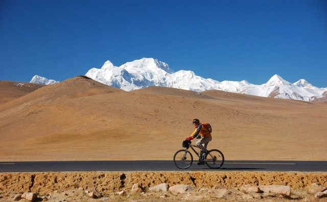 A mountain bike riding across the Tibetan plateau, a perfect eco tourism activity in Tibet