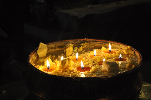 Offering butter lamps to the Buddha, Kham, Tibet
