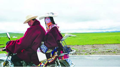 Tibetan Family in bike